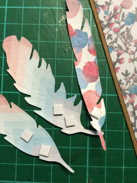 Apply foam squares to the bottom of the feathers