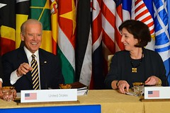Vice President Joe Biden shares a laugh with Assistant Secretary of State for Western Hemisphere Affairs Roberta Jacobson before the start of a multilateral meeting during the Caribbean Energy Security Summit at the U.S. Department of State in Washington, D.C., on January 26, 2015. [State Department photo/ Public Domain]