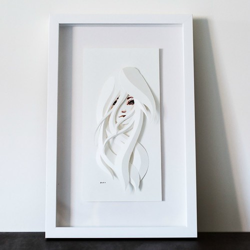 Illustrated Paper Sculpture of woman's head in white frame
