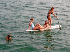 sailing(0.0), waterskiing(0.0), boating(0.0), surface water sports(1.0), sports(1.0), sea(1.0), water sport(1.0), stand up paddle surfing(1.0), paddle(1.0),