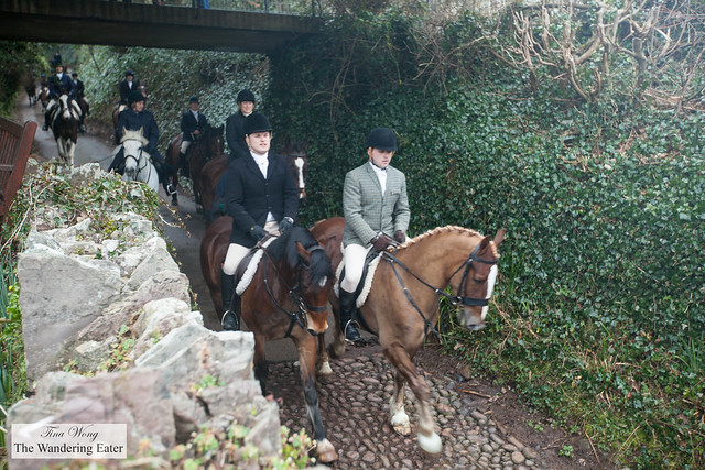 A large group out for foxhunting, passing through St Martins Church