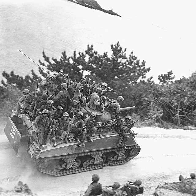 After the 29th Marines cut off the Motobu Peninsula and seized Chuda at 1200 Hours, Marines riding a M4A3 Sherman of Company A, 6th Tank Battalion during the 6th Marine Division's drive along the west coast of Okinawa, Japan. 6 April 1945.