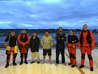 An MH-65 Dolphin helicopter crew from Coast Guard Air Facility Newport, Ore., poses for a photo at the facility with three crew members of the fishing vessel Blazer after they were rescued from their life raft following the sinking of their vessel eight miles west of Siletz Bay, Ore., Nov. 29, 2014. The other two Blazer crew members were rescued by a 47-foot Motor Life Boat crew from Coast Guard Station Depoe Bay, Ore. (U.S. Coast Guard photo courtesy of Coast Guard Air Facility Newport)