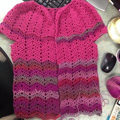 In the office. But doing a little #crocheting