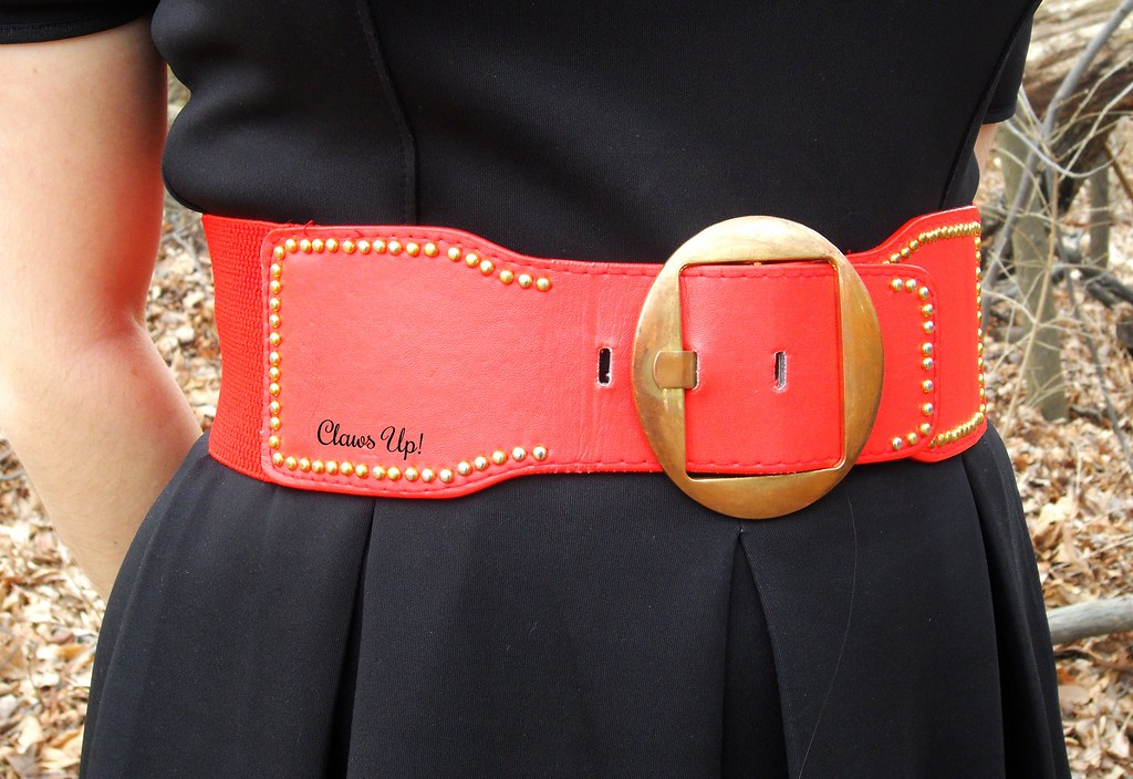 Large red and gold belt and black dress