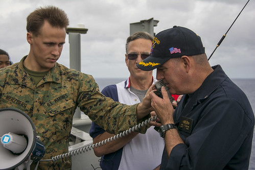 "PACIFIC OCEAN - Capt. Jon Rodgers, Commanding Officer of the amphibious assault ship USS Makin Island (LHD 8), uses an amateur (HAM) radio to speak to Capt. Barry ""Butch"" Wilmore, the current commander of the International Space Station."