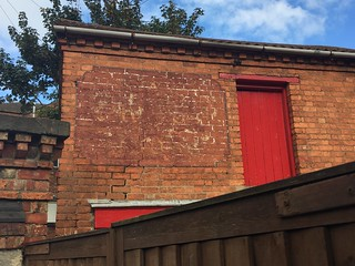 Faded ghost sign, 69 Midland Road, Wellingborough
