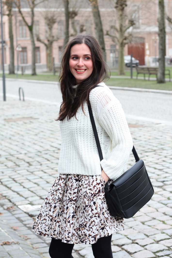 office appropriate outfit: turtle neck sweater, printed skirt