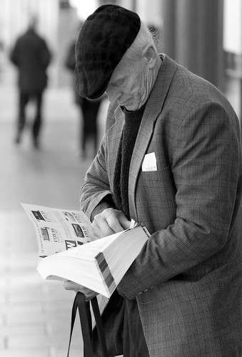 street uk urban bw white man black monochrome hat wales photography prime mono candid cymru cardiff streetphotography olympus cap caerdydd f18 unposed catalogue 45mm omd m43 mft primelens em5 mzuiko justard justardcom
