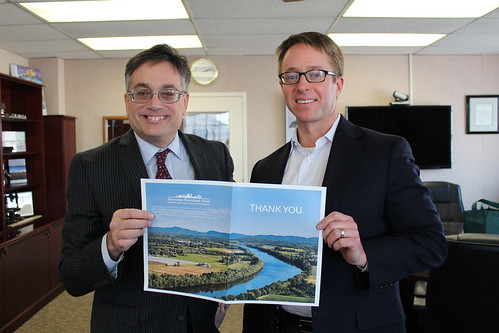 American Farmland Trust President Andrew McElwaine presents NRCS Chief Jason Weller (right) with a thank you card with more than 1,300 signatures. NRCS photo.