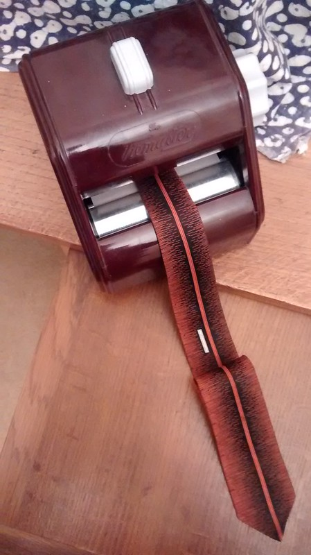 A Corby Tiemaster tie press and vintage tie