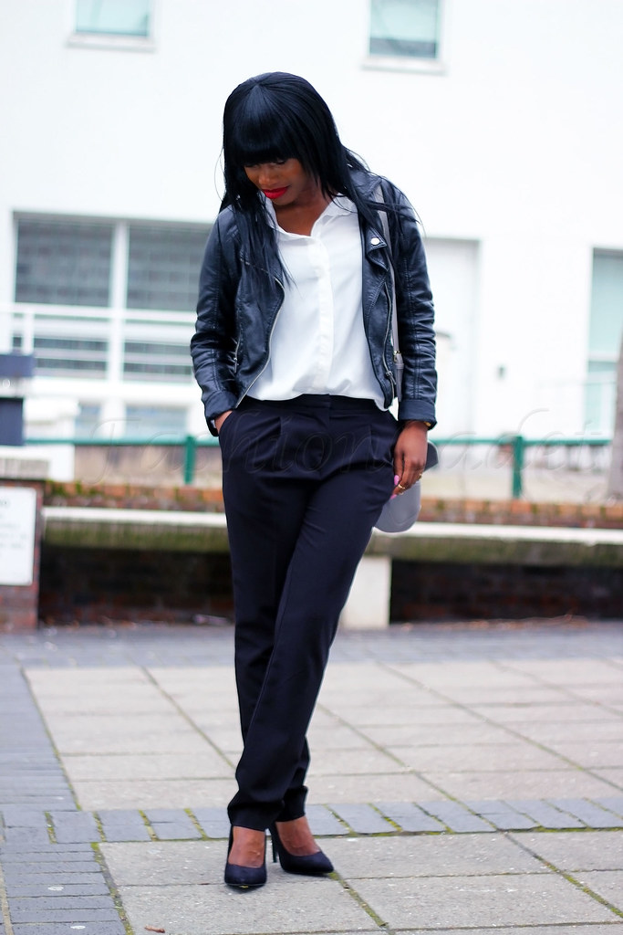 chic-office-wear-style, black trousers, loose pants, loose trousers, black leather jacket, biker jacket, black biker jacket, grey handbag, white blouse, white sheer blouse, sheer blouse, sheer top, pointed heels, black pointed heels, monochrome outfit, monochrome it
