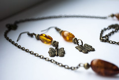 bracelet(0.0), amber(1.0), art(1.0), jewellery(1.0), chain(1.0), necklace(1.0), bead(1.0),