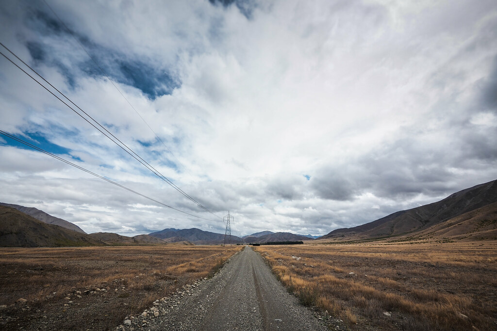 Long straight gravel road along the Acheron River valley, Molesworth Muster Trail, New Zealand