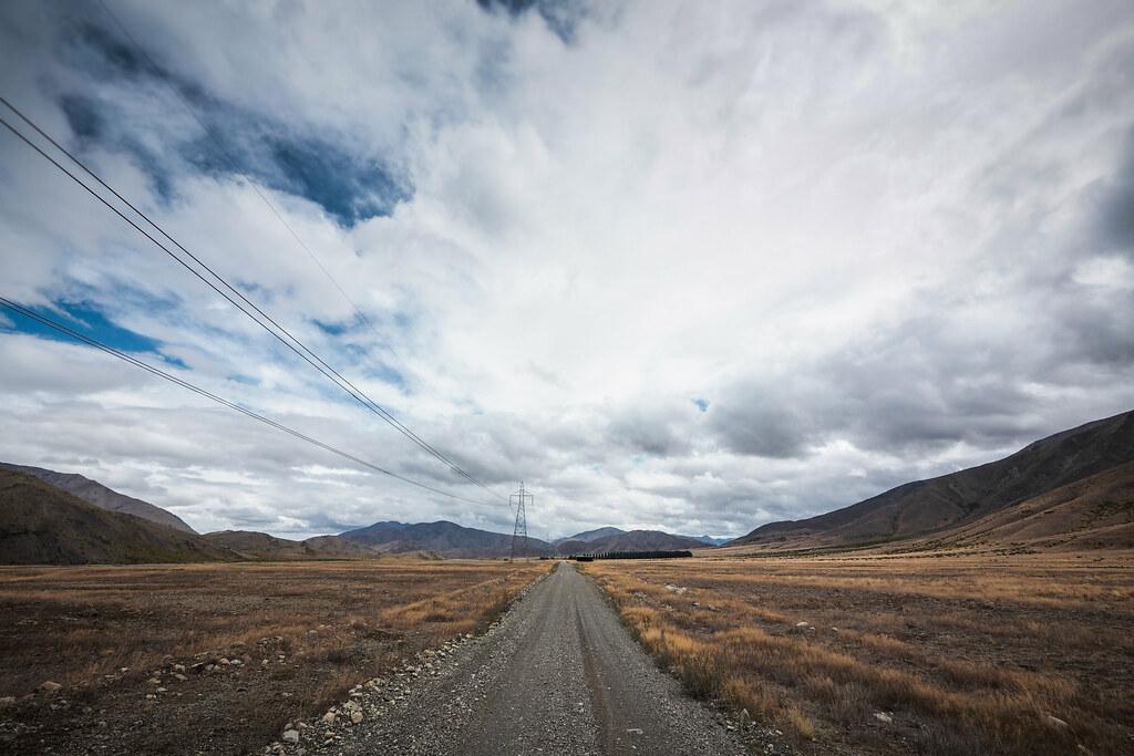 Long straight gravel road along the Acheron River valley, Molesworth Muster Trail, New Zealand