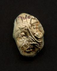 carving(0.0), head(0.0), bone(0.0), skull(0.0), organ(0.0), art(1.0), sculpture(1.0), fossil(1.0),
