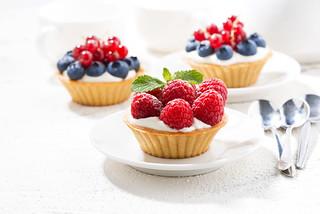 mini tarts with cream and berries