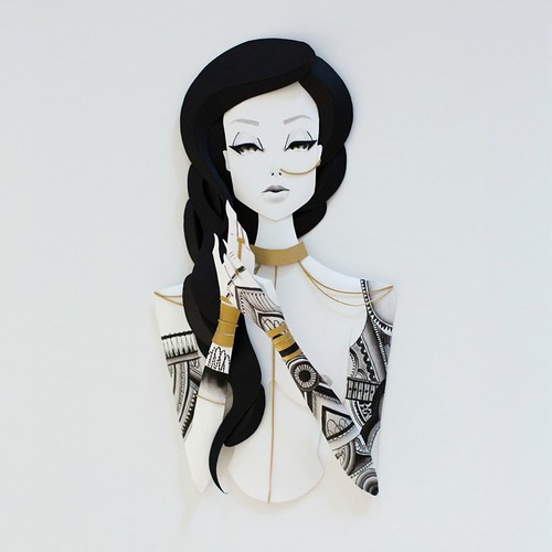 Illustrated Paper Sculpture - woman with long dark hair and inked arms