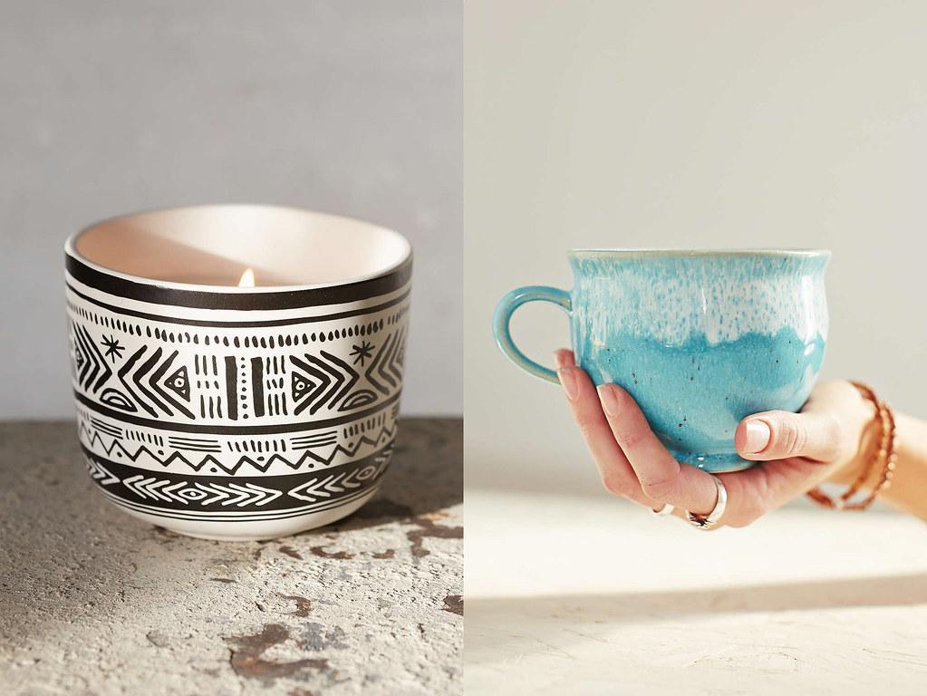 candle and ceramic mug