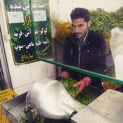 Iranian man cutting vegetables at the bazaar. Persians eat green plants and vegetables along with the everyday meals. Healthy and aromatic plants make perfect side dish. #iran #instairan #picoftheday #iranian #persian #persia #irani #iranianguys #iranianm