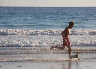 Boy Running with his Dog - Playa Barrigona - Costa Rica