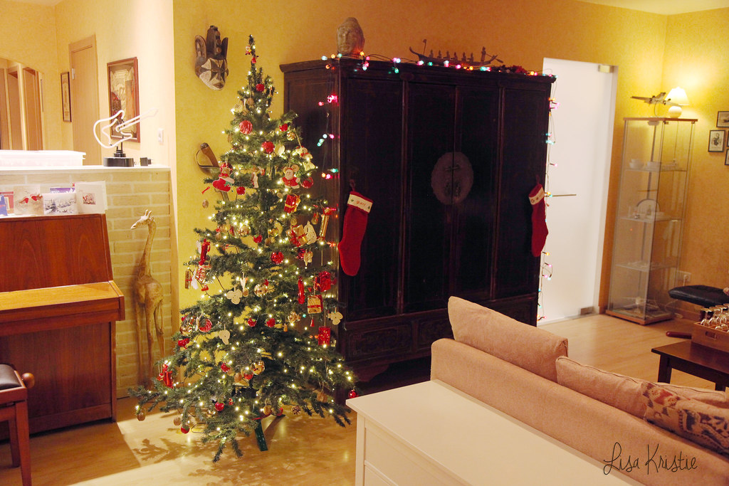 christmas eve evening tree cozy winter festivities celebration interior decoration livingroom red stockings socks lights