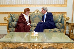 U.S. Secretary of State John Kerry chats with Omani Foreign Minister Yusuf bin Alawi on March 5, 2015, in Riyadh, Saudi Arabia, before the two attend a meeting of the regional Gulf Cooperation Council. [State Department photo/ Public Domain]