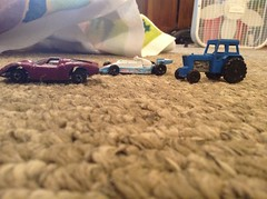 Unnamed Alfa Romeo, Matchbox Ford Tractor, and Tomica Mclaren M26 Ford