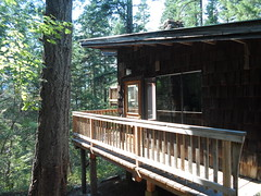 outdoor structure(0.0), boathouse(0.0), hut(0.0), wood(1.0), shack(1.0), porch(1.0), deck(1.0), log cabin(1.0),