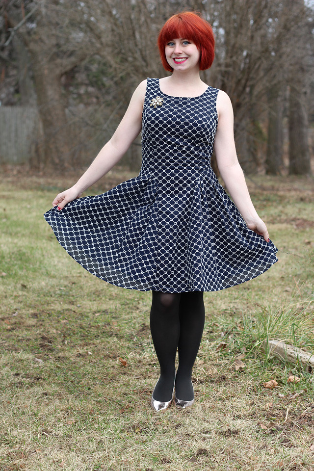 Navy Blue Lattice Print Dress, Vintage Brooch, Dark Gray Tights, and Gold Heels