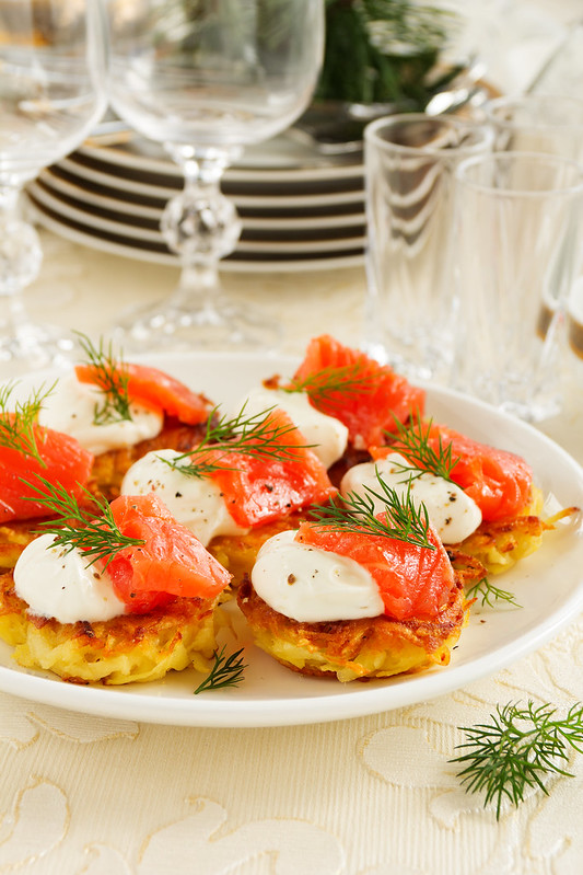 Appetizer of hash browns and red fish.