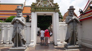 Stone guardians at Wat Pho
