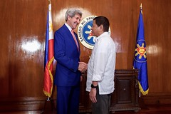 U.S. Secretary of State John Kerry shakes hands with Philippines President Rodrigo Duterte on July 27, 2016, in the Malacañang Palace in Manila, Philippines, before the two held a working lunch. [State Department Photo/Public Domain]