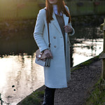 Winter white coat, fedora and riding boots