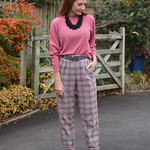 Soft pink, grey plaid trousers and black cut away heels