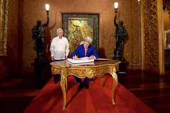 Philippines Foreign Secretary Perfecto Yasay watches as U.S. Secretary of State John Kerry signs the guestbook in the Malacañang Palace in Manila, Philippines, on July 27, 2016, before the Secretary held a working lunch with Philippines President Rodrigo Duterte. [State Department Photo/Public Domain]