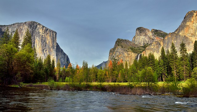 Standing on the Banks of the Merced River and Taking in an Amazing View of Mountain Peaks (Yosemite National Park)