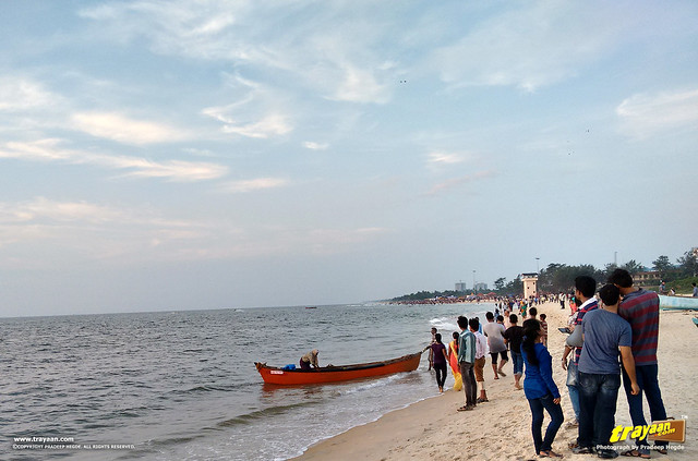 Fishermen and their boat, people and the crowd on a weekend evening in Panambur Beach, Mangalore, Mangaluru, Dakshina Kannada, Karnataka, India