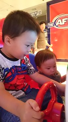 Isaac and Liam driving a car at Chadstone