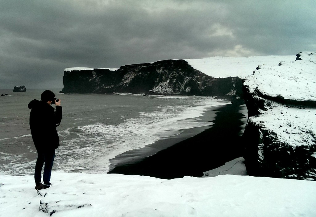 Taking photos at Black Beach