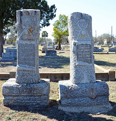 Two Woodmen of the World grave monuments