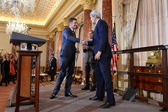 U.S. Secretary of State John Kerry congratulates Randy Berry as the first-ever Special Envoy for the Human Rights of LGBT Persons at a welcome reception in the Special Envoy Berry's honor at the U.S. Department of State in Washington, D.C., on February 27, 2015. [State Department photo/ Public Domain]