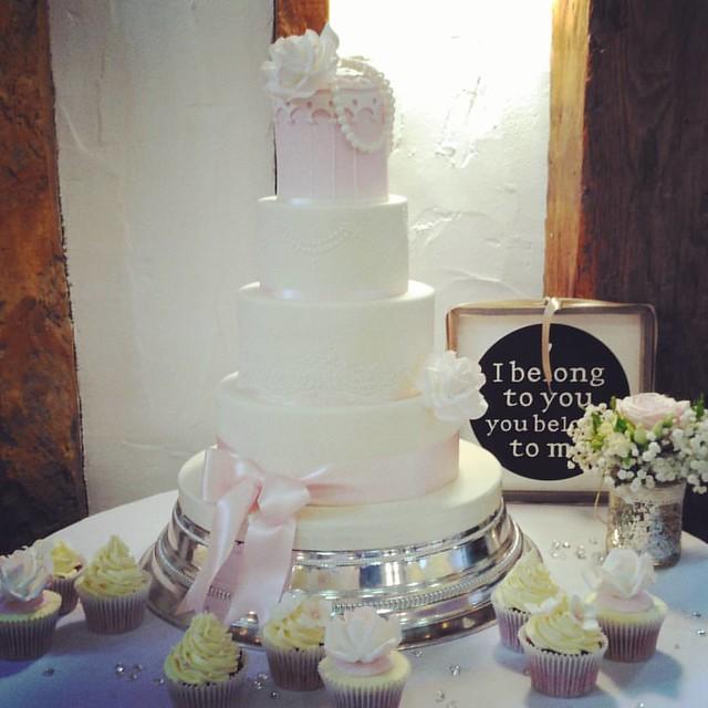 A birdcage cake with cupcakes, at the Tudor barn.