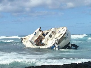 The Coast Guard and the Hawaii County Fire Department are searching for a possible person in the water off of the Big Island, Hawaii, Jan. 3, 2015. The 74-foot sailing vessel, Hawaii Aloha ran hard aground with five persons on board. (U.S. Coast Guard photo)