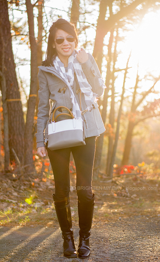gray and white wide striped scarf, gray toggled coat, colorblocked crossbody bag, black riding boots