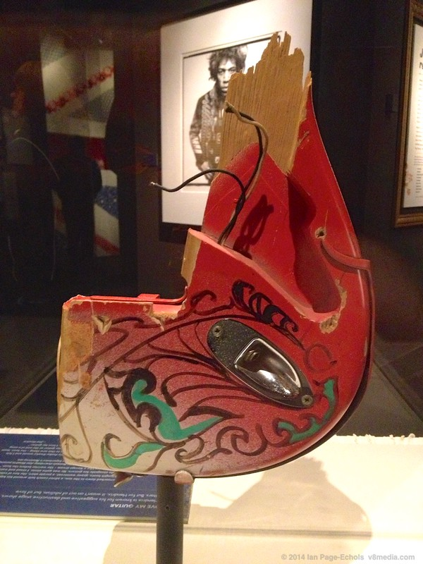 Jimi's red guitar with paint and marker drawing at the EMP