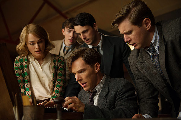 Keira Knightley (left) and Benedict Cumberbatch (center) break the code together in THE IMITATION GAME.