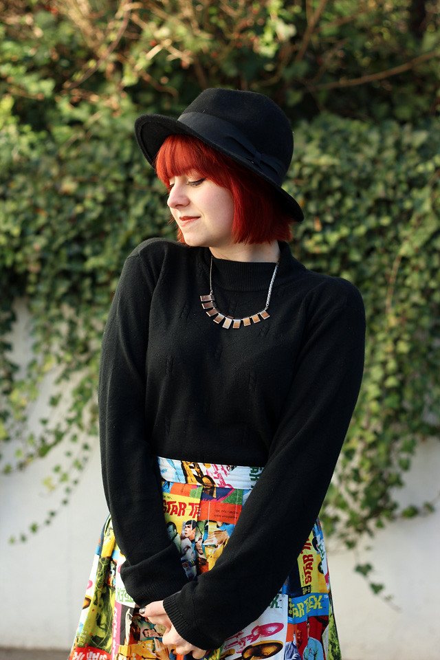Black Mock Turtleneck Sweater, Black Hat, and a Star Trek Skirt