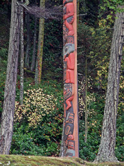 trail(0.0), outdoor structure(0.0), stele(0.0), totem pole(1.0), art(1.0), woodland(1.0), tree(1.0), sculpture(1.0), forest(1.0),