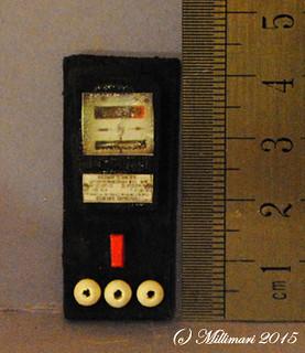 Sähkömittari ja sulakkeita